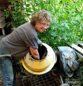 woman with hand in cement mixer