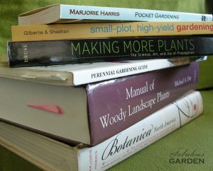 stack of gardening reference books