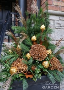 Christmas outdoor urn decorated with urn accessories